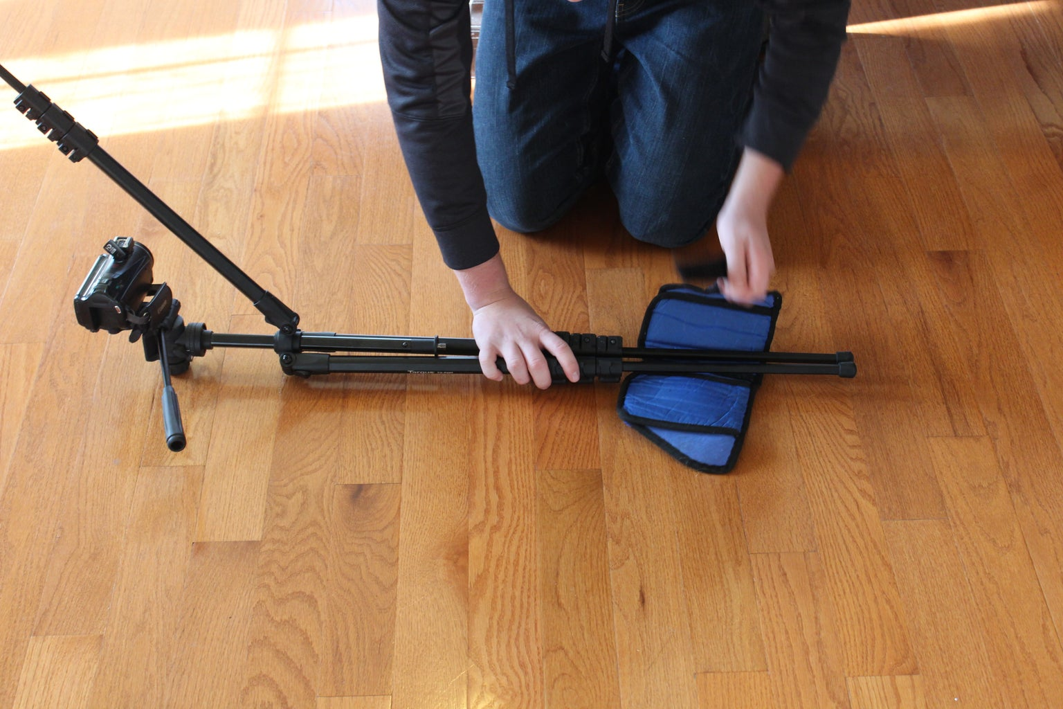 Pull One of the Tripod Legs Up As Shown.  Add Counter Balance Weights to the Other Two Legs