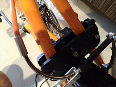 Use 3pcs M4 X 35mm Screw and Nyloc Nuts to Mount TOP.STL and BOTTOM.STL Onto Bike