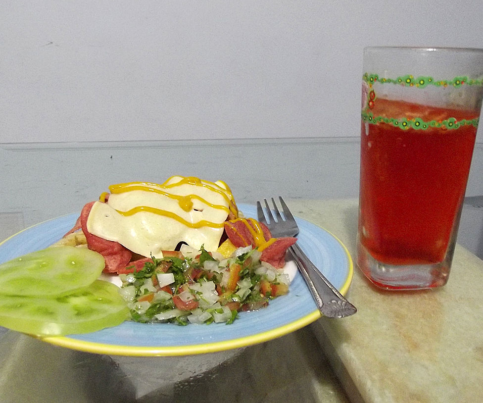 Hot dogs and potatoes - Salchipapas - with Refajo (Colombian Dish and Drink)