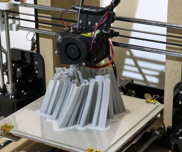 Build and Improve a 3D Printer