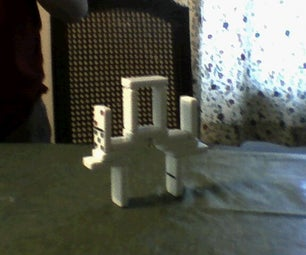 How to Make an Almost-Impossible Domino Bridge