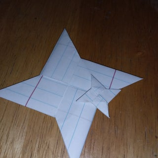 How to Make a Ninja Star Out of Notebook Paper!