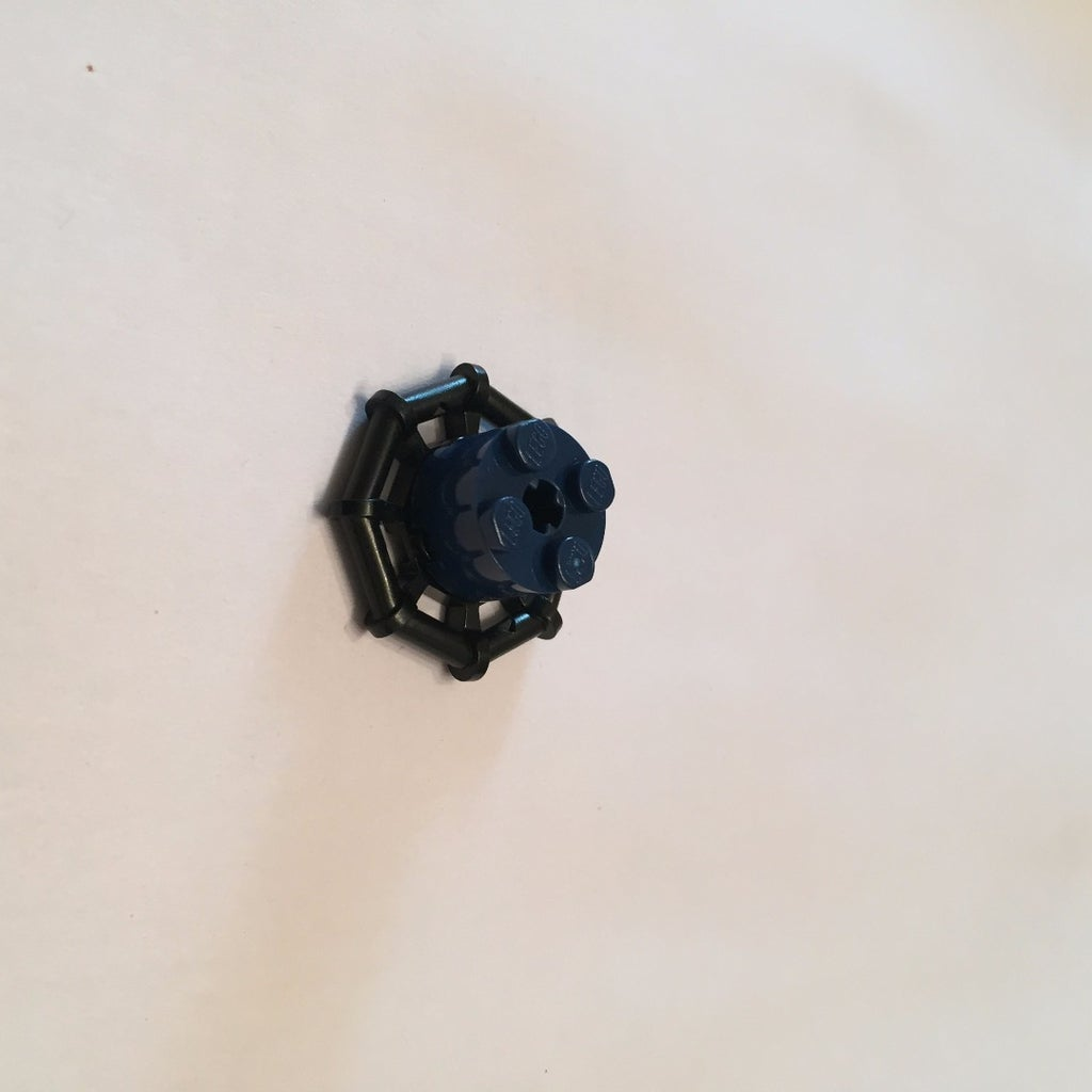 Place Dark Blue 2x2 Cylinder on Black Octagon