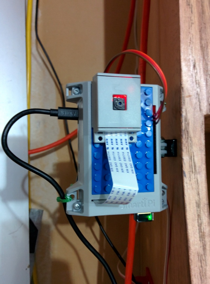 Raspberry Pi Garage Door Opener with streaming video of door status.