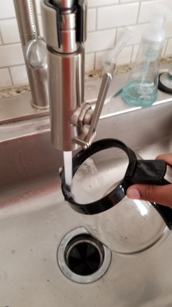 Wash Out Coffee Pot With Water