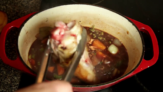 Add the Shanks to the Pot, Making Sure the Meaty End Faces Down.