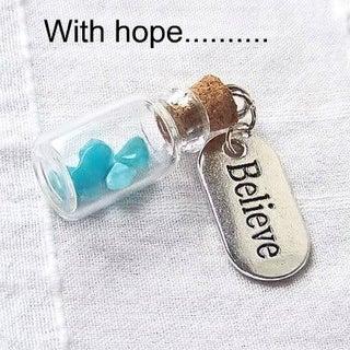 believe necklace with bottle.jpg