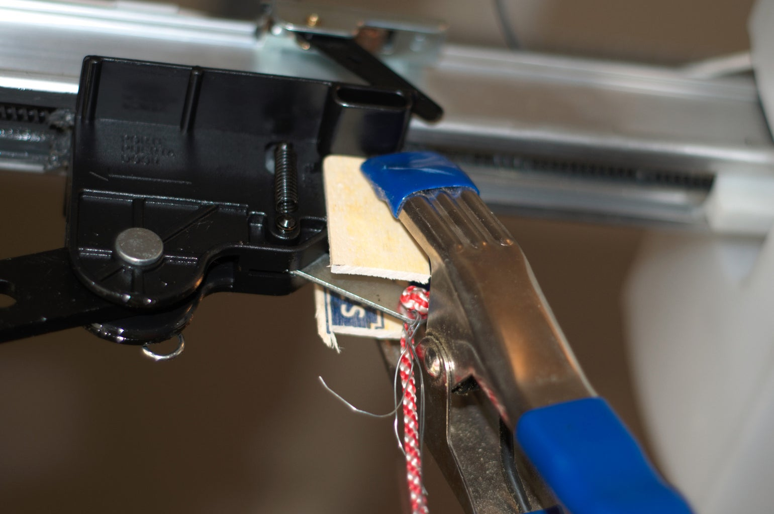 Use High Strength Multi-surface Adhesive to Attach the Barriers to the Release and Clamp Until Dry