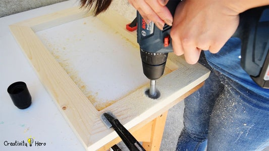 Drilling Holes for the Light Bulb Sockets.