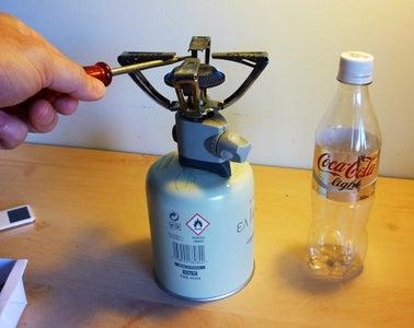 Pierce the Coca Cola Bottle
