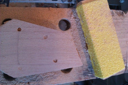 Put in the Holes for the Tuning Pegs, Thickness the Headstock and Shape the Neck.