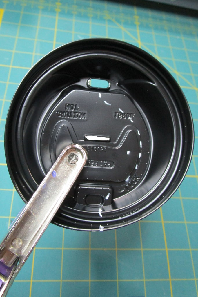 Cut Holes in the Lid for the Battery and Tape