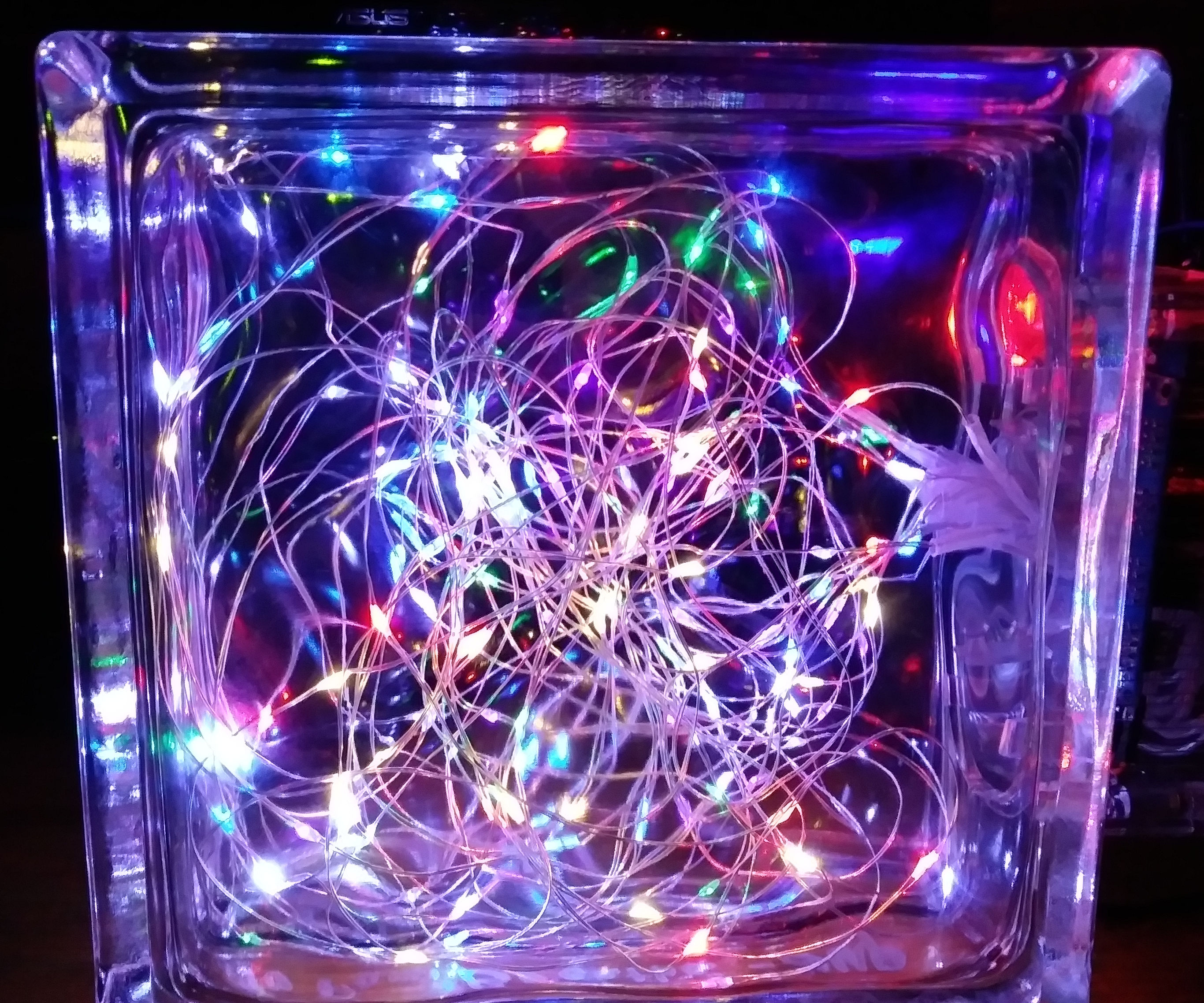 Breathe: Glowing LED Strands in a Glass Block
