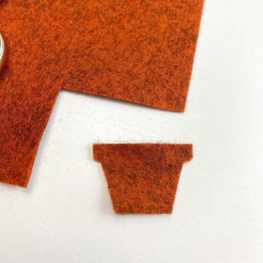 Cut a Flowerpot Shape Out of Brown/ginger Felt. Stitch Borders