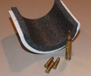 Gun rest for camera tripod