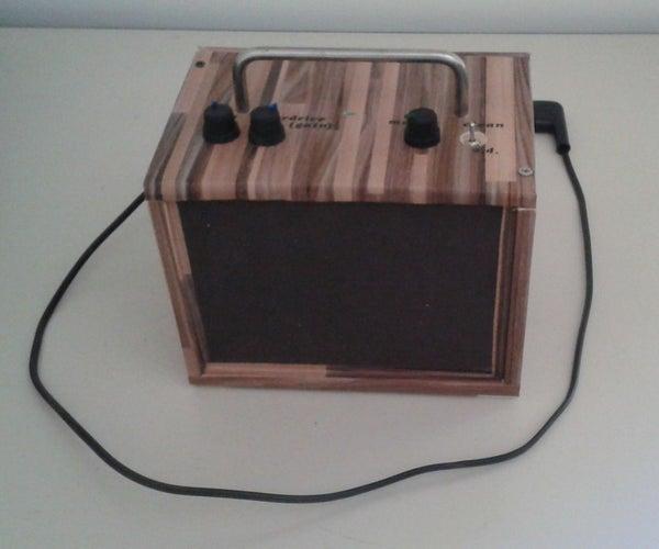 10 WATT PORTABLE GUITAR AMP WITH DISTORTION