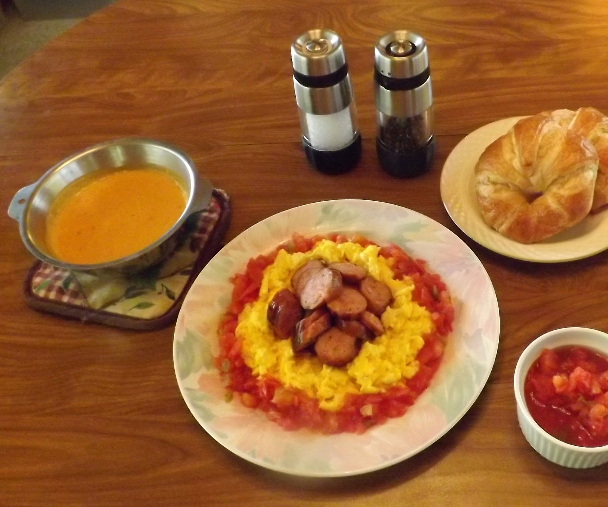 CAJUN SMOKED SAUSAGE & SCRAMBLED EGGS with TOMATOES & CHEESE SAUCE