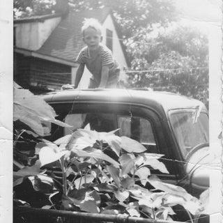 Karl washing old car.jpg