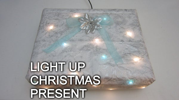 Christmas Present That Lights Up When You Put It Under the Tree