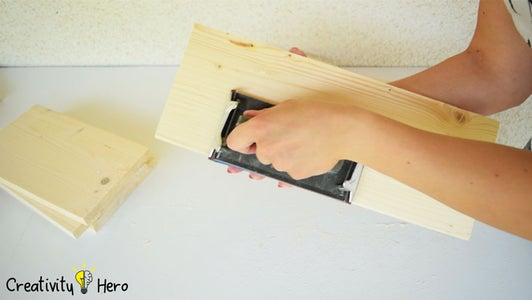 Sanding the Pieces of Wood.