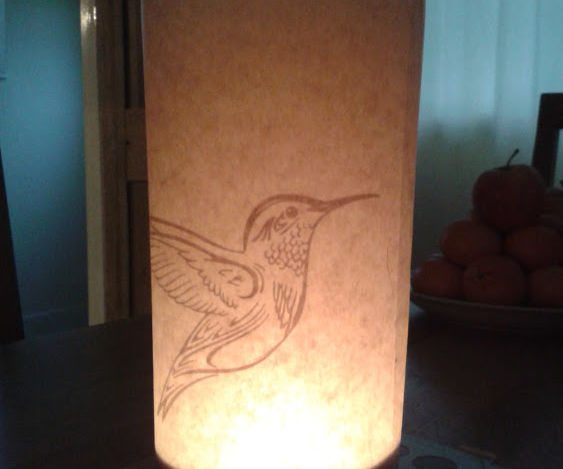 Make a paper cut out tealight candle lamp