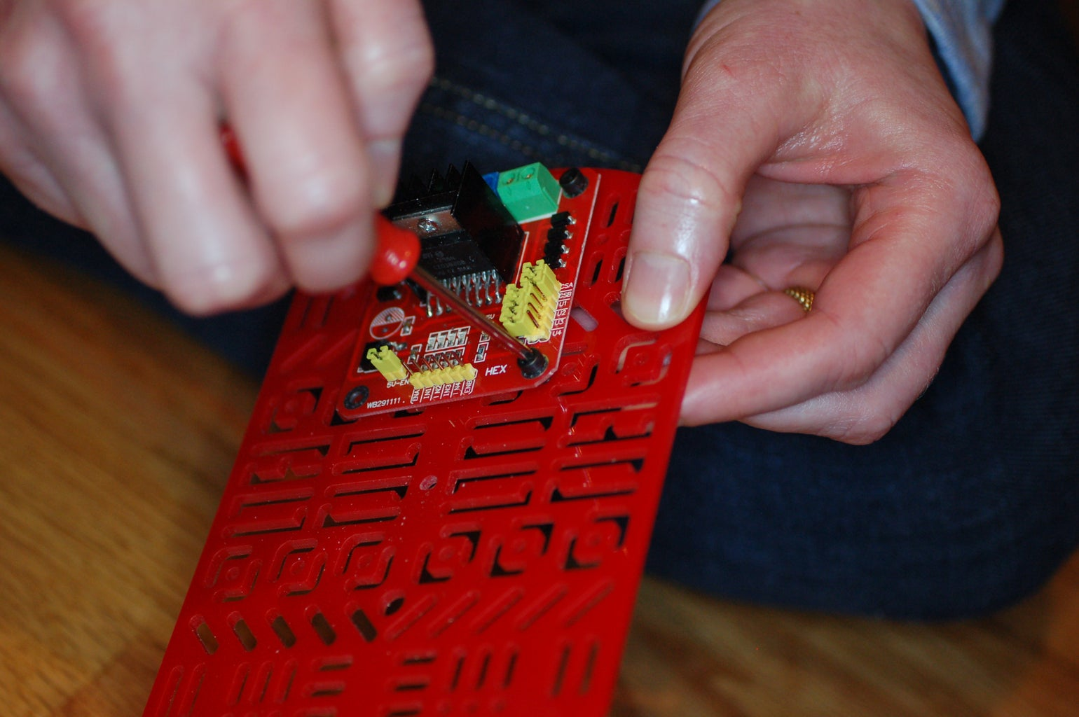 Attach the Microcontroller and Motor Driver to the Underside of the Top Body Deck