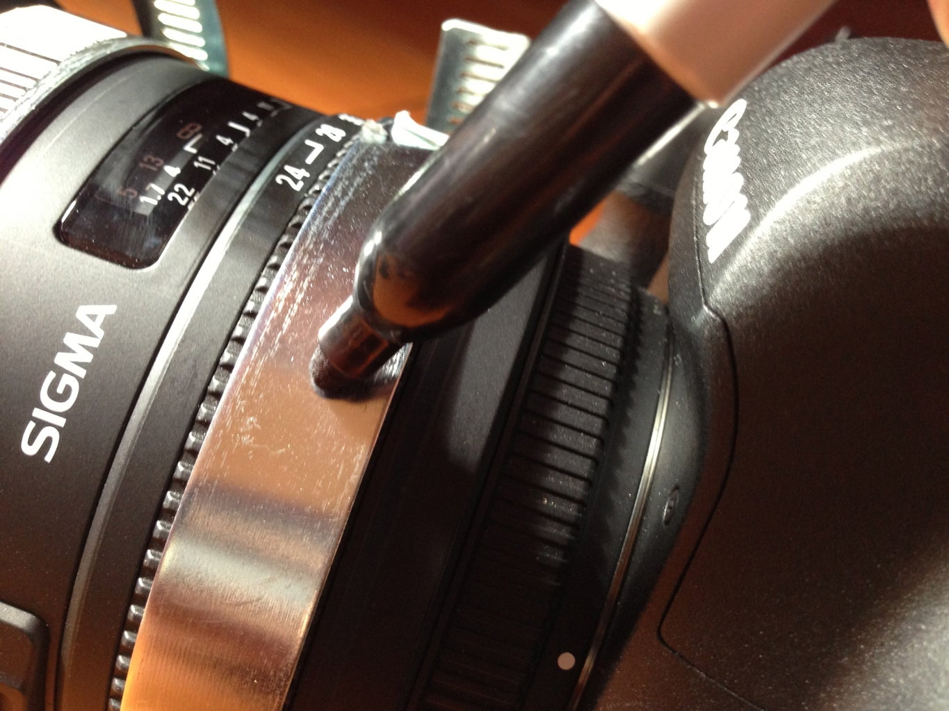 Fit Clamps to Lens and Mark