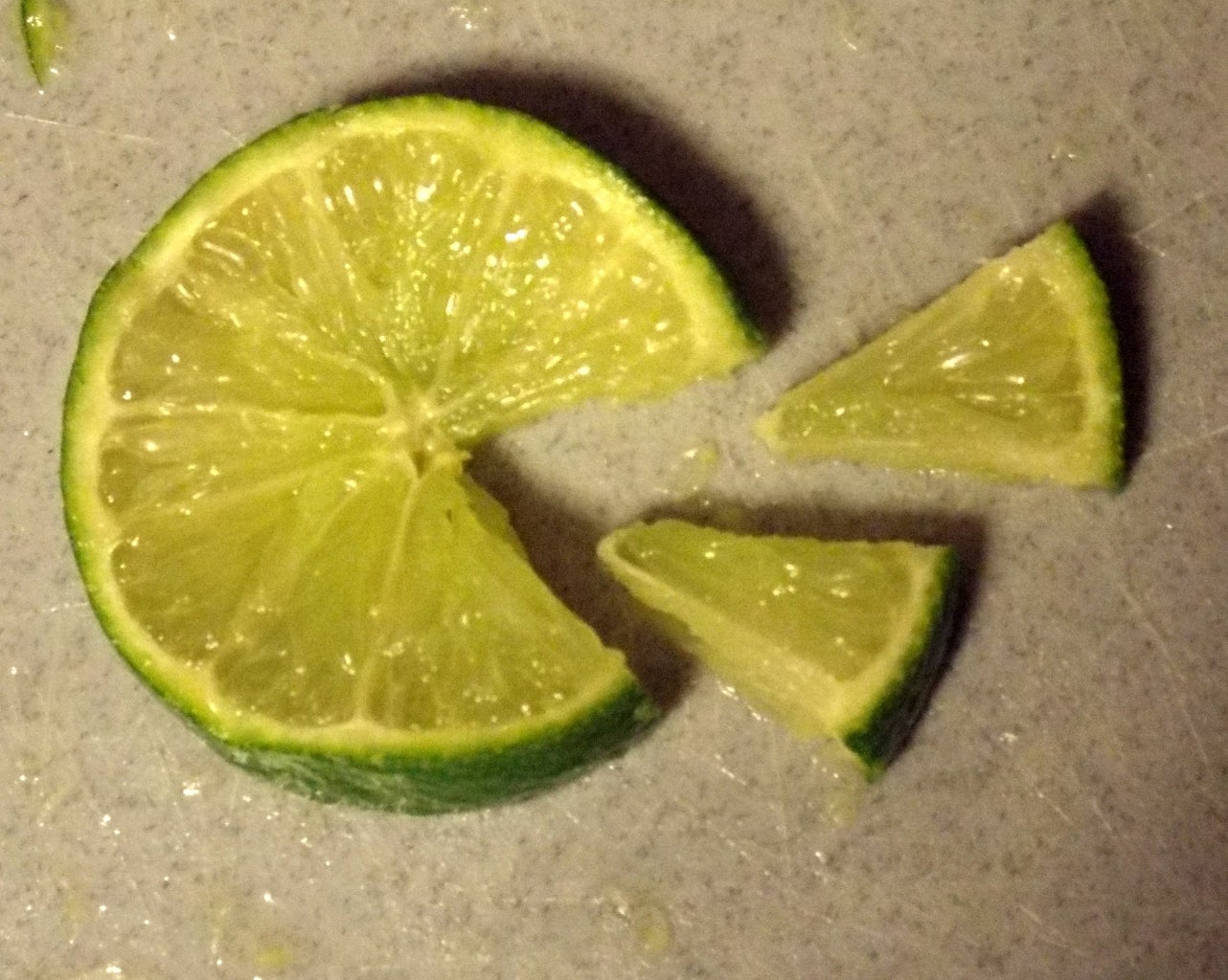 Cut the Lime Into Slices, Then Cut Each Slice Into Small Triangles.
