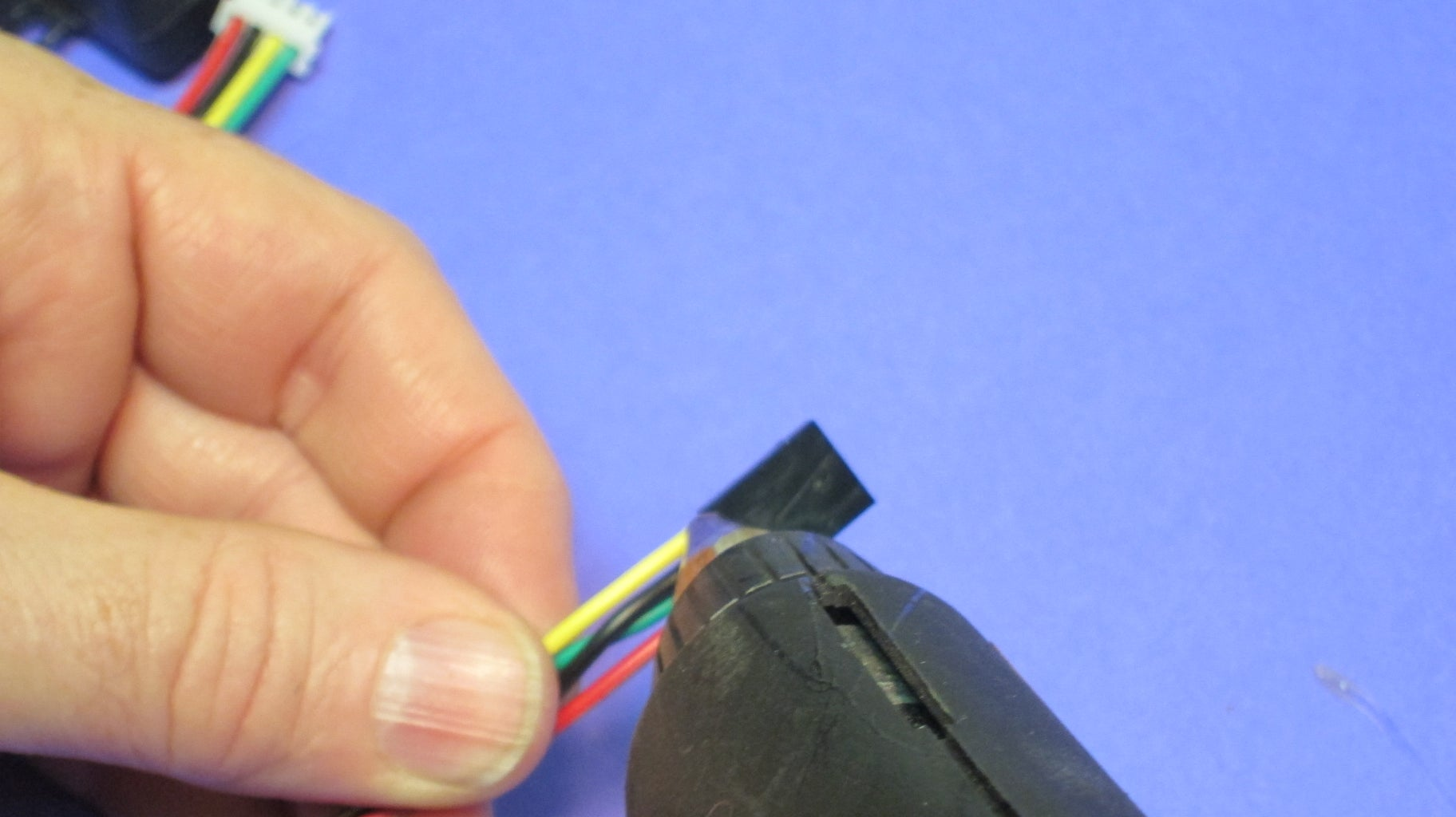 Hot Glue the Wire/housing Joints