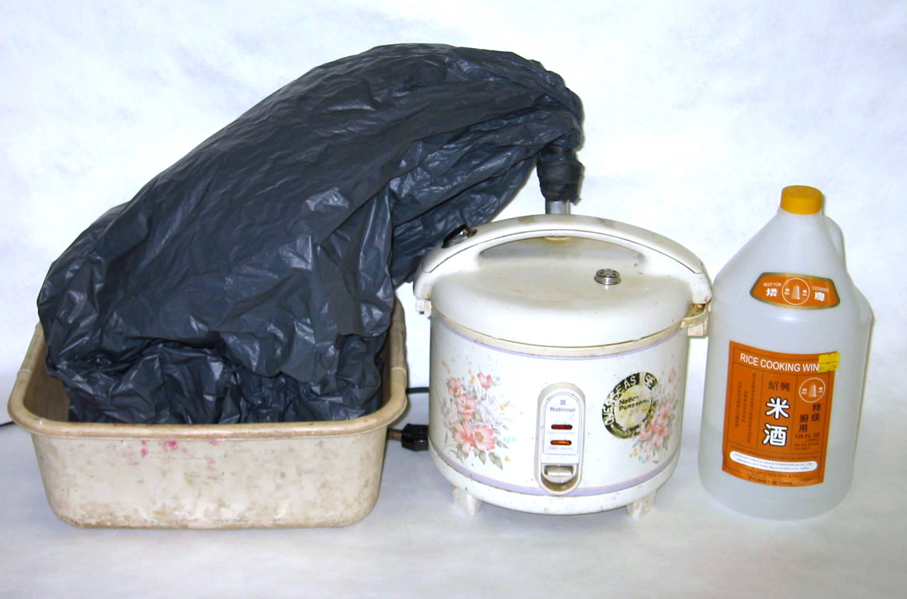 Garbage Bag + Rice Cooker = Alcohol Still