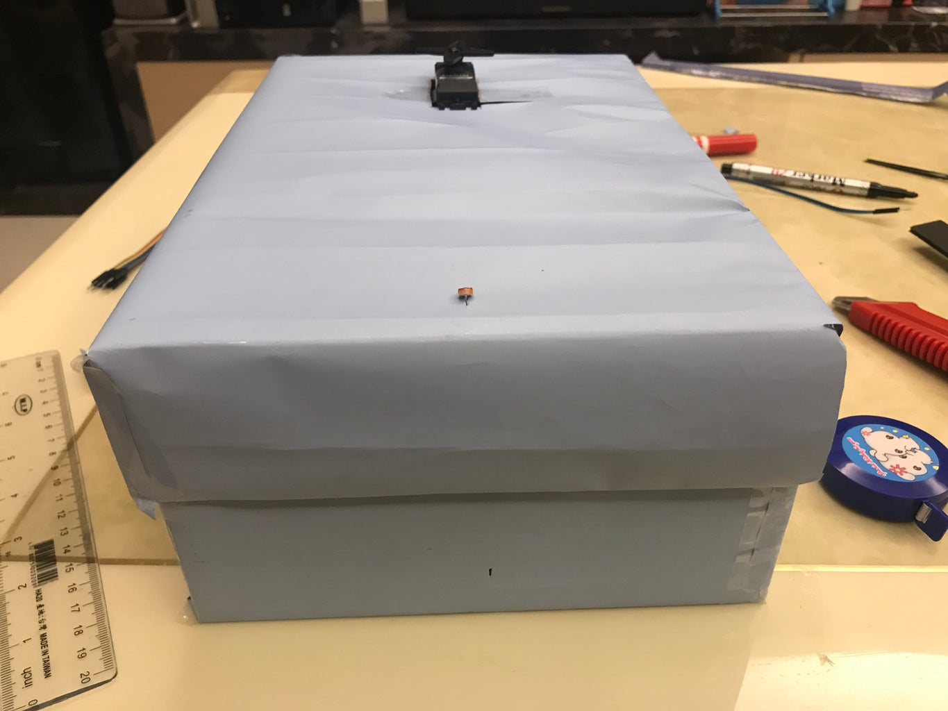 Make a Nick, in the Position Indicated on the Drawing, on the Smallest Side of the Box (the Side Below the Photoresistor As Shown in the Photo)