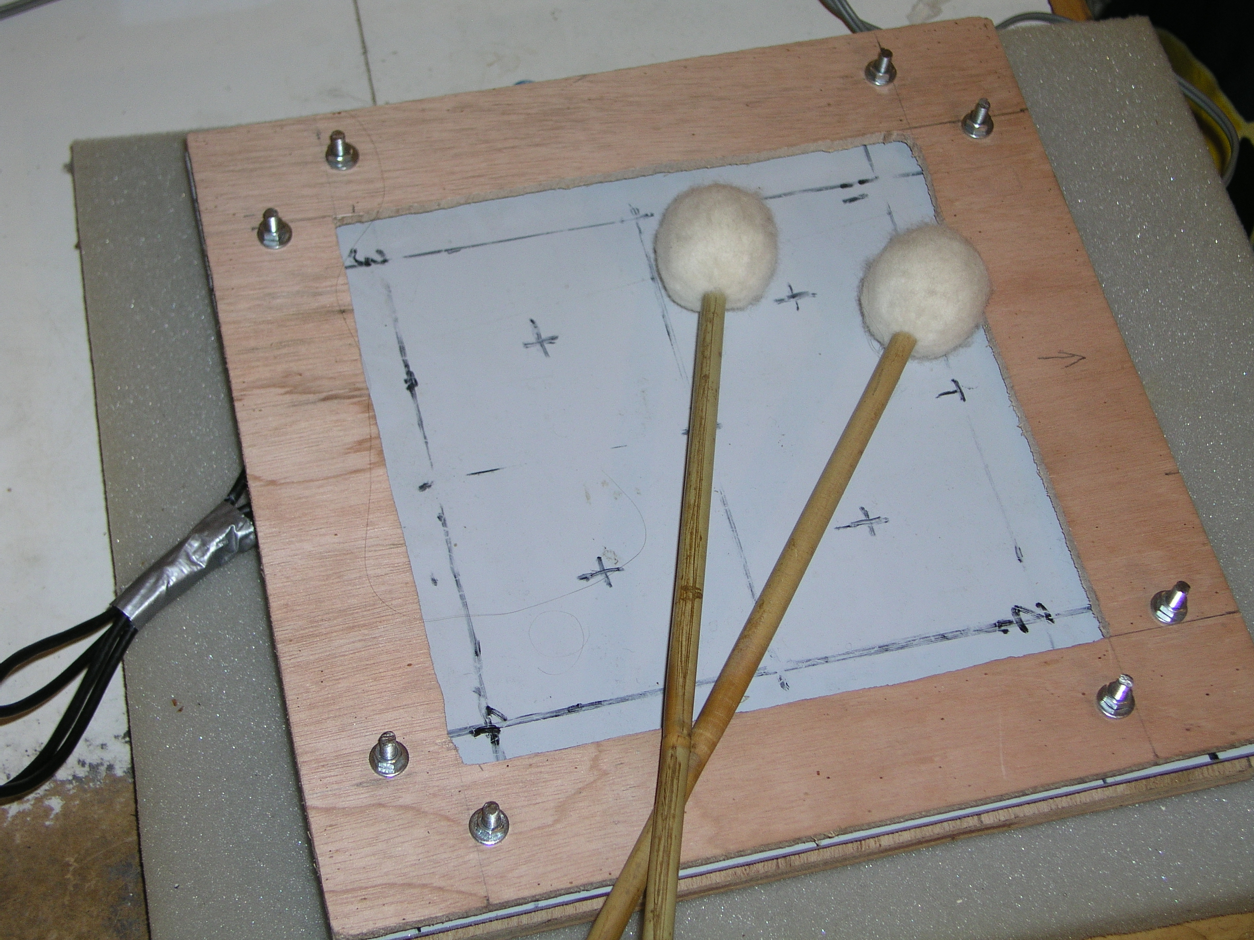 A position sensitive midi drum pad