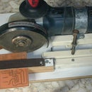 ٍEasy PCB cutter with a grinder on a chasis