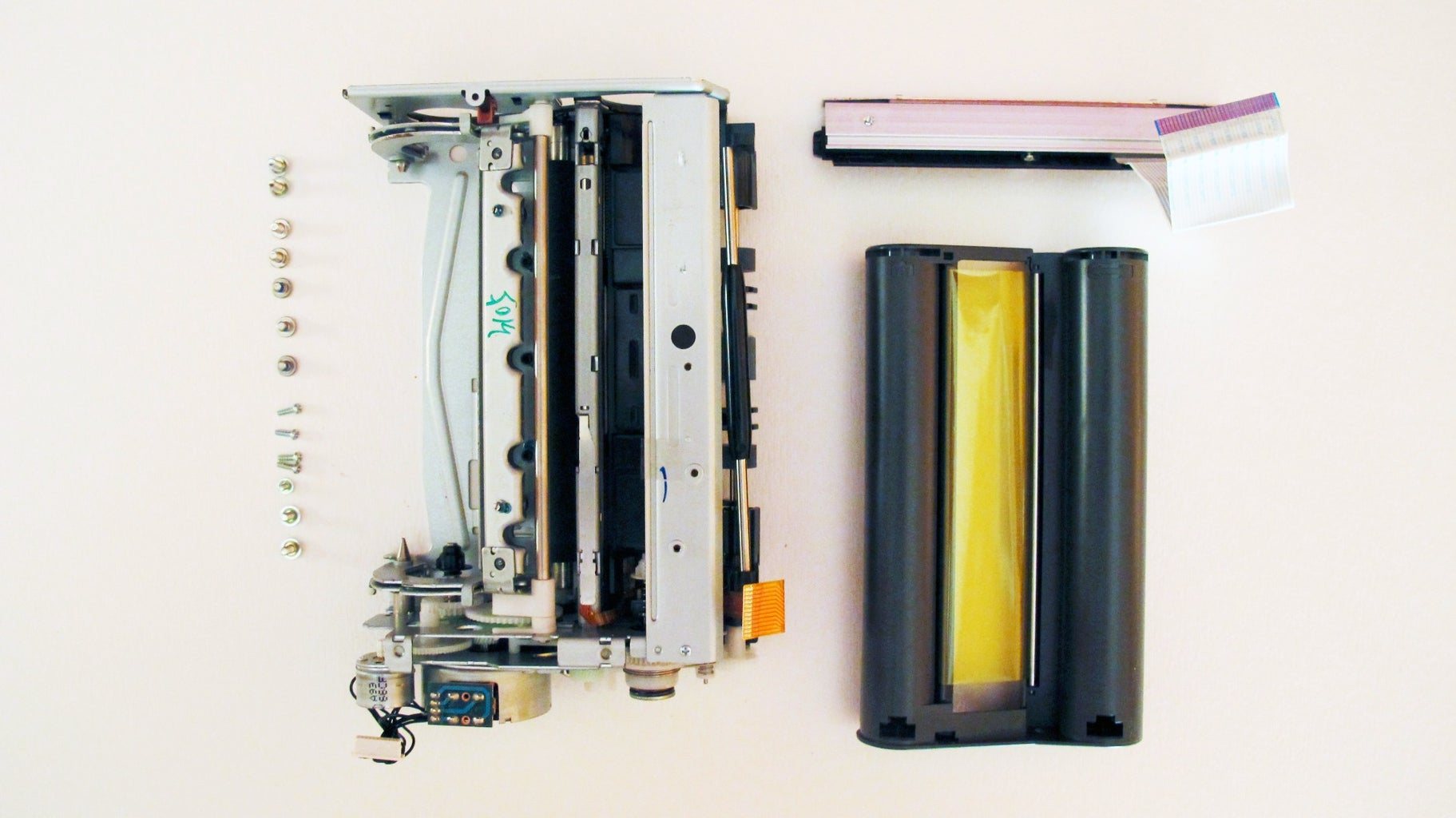 Isolate the Reeling Mechanism From a Compact Photo Printer