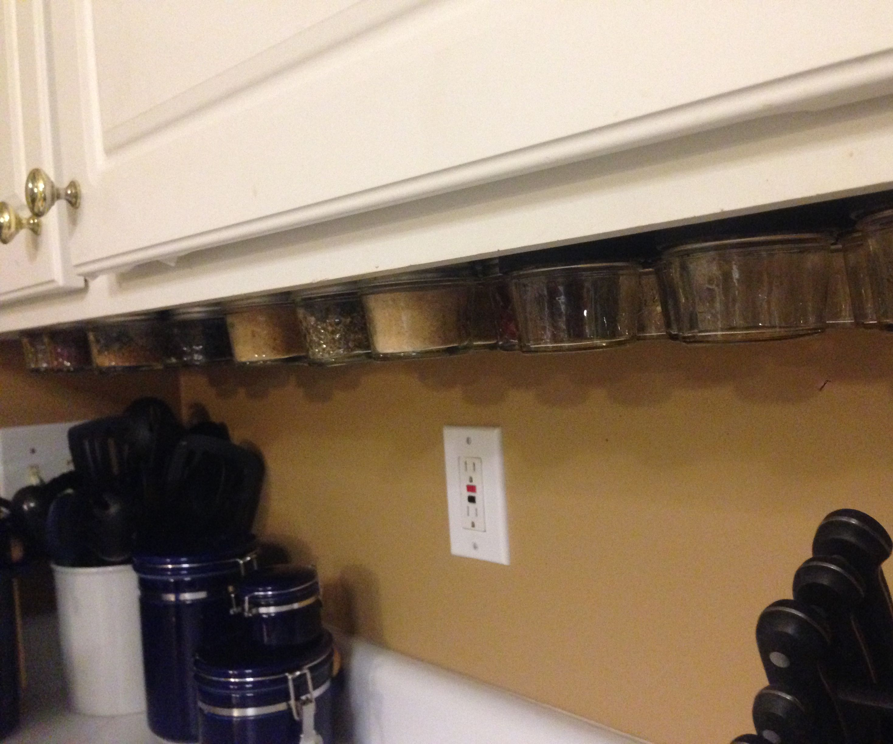 Magnetic under cabinet spice rack