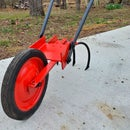 Wheel Hoe - Hand Tractor - Garden Implement Extraordinaire