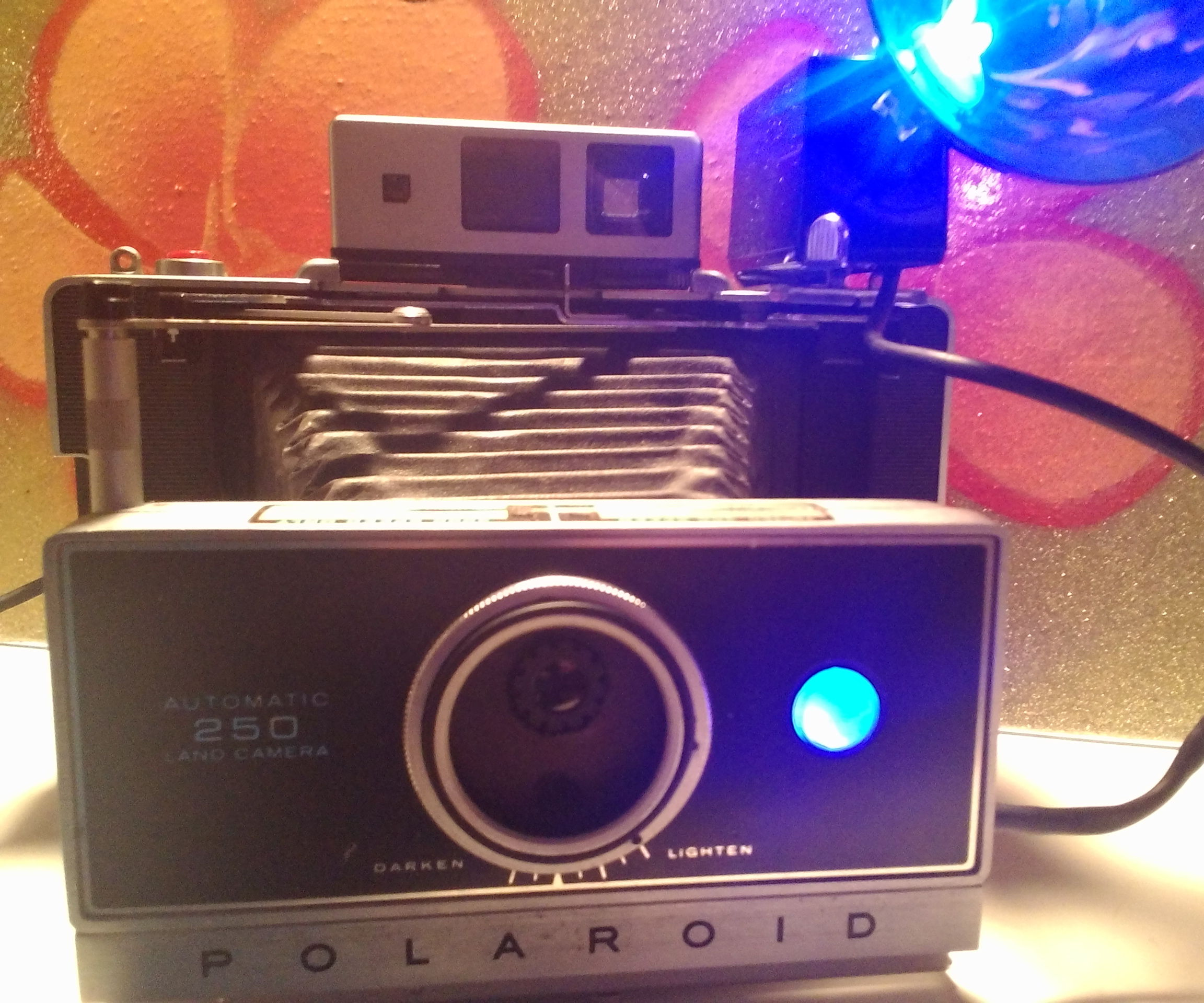 Let's turn a vintage camera into a decorative web cam and light!