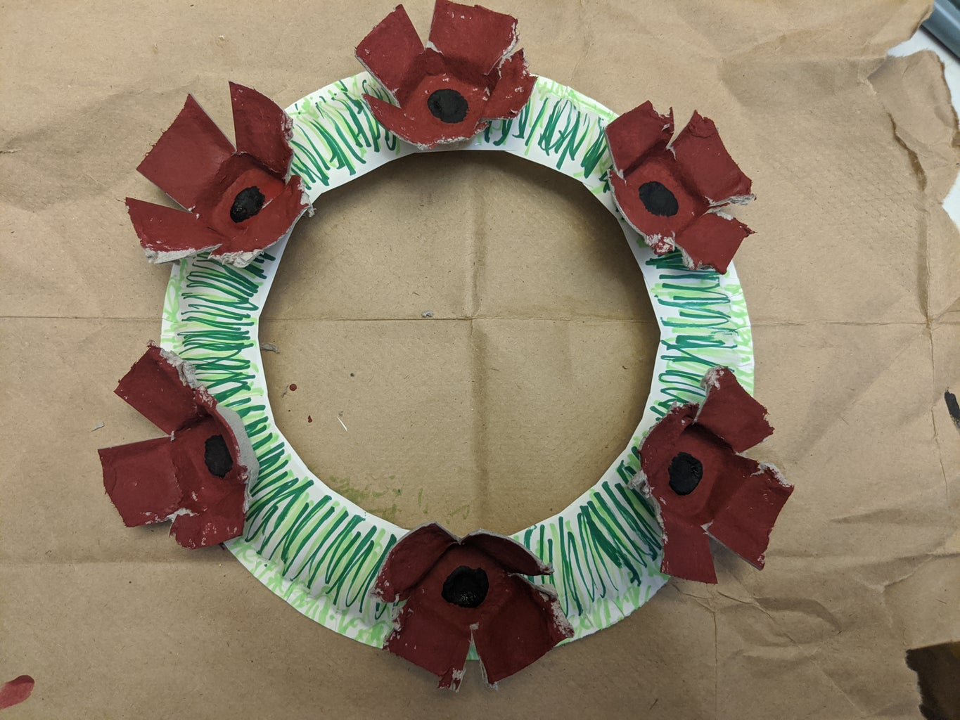 Glue the Poppies on Your Wreath.