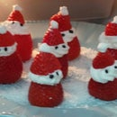 Decorated dessert - Santa Claus made from strawberries and whipped cream