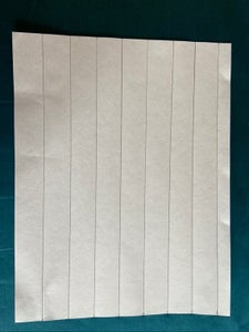 Cut 1inch (2.5 Cm) Wide Strips of Paper at Least 8 Inches (20 Cm) Long.