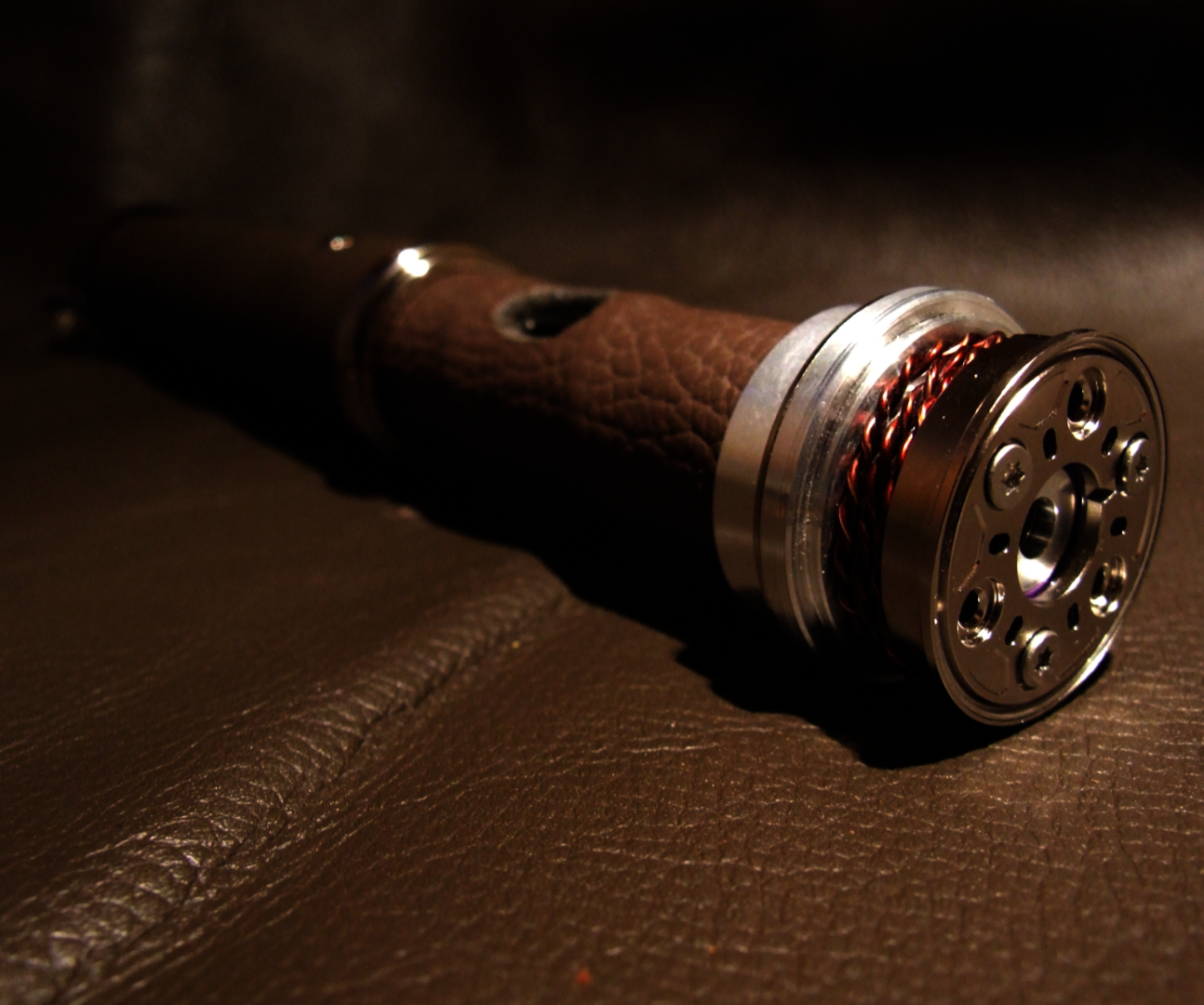 Custom highlighted leather wrapped Lightsaber (a new photo)