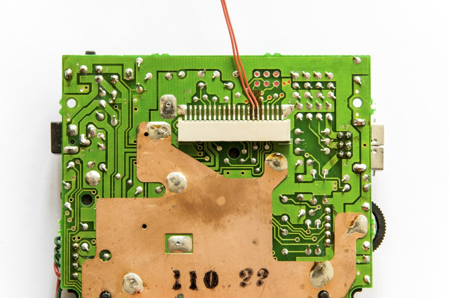 Optionally Remove Existing Solder on the Data, Ground, and Power Pads on the DMG Mainboard