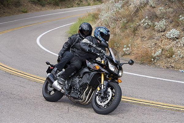 Being safe as a pillion passenger on a motorbike.