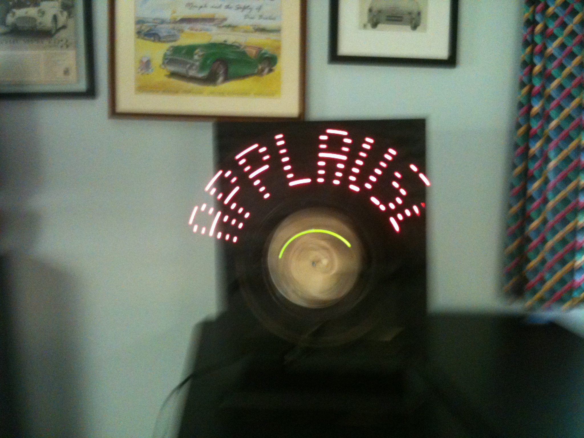 "Arduino + LEDs + fan = POV ""APPLAUSE"" sign"