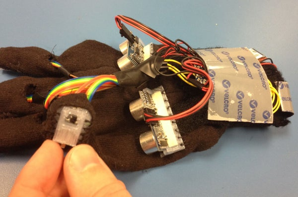 HandSight: a Glove for the Blind to Feel Shapes and Navigate Obstacles