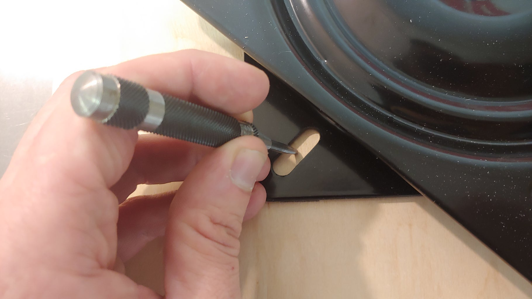 Step 2: Center and Mount the Swivel Base to the Bottom Piece