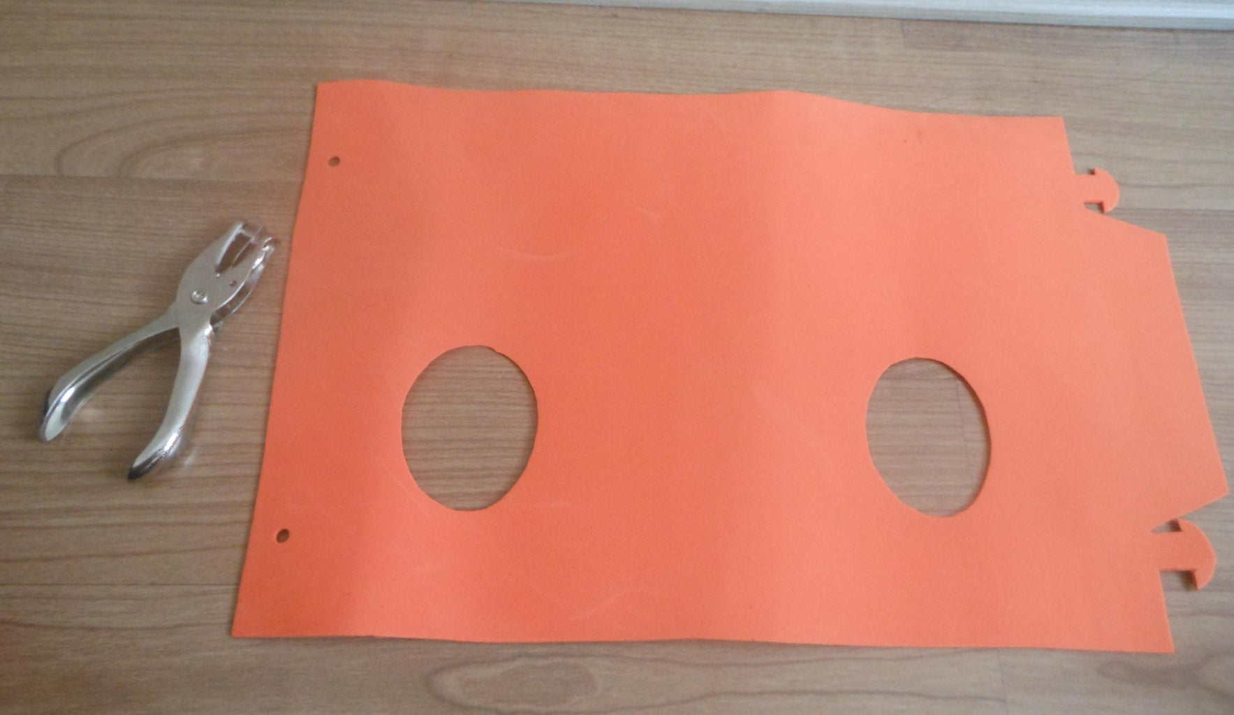 Use the Punching Tool to Punch 2 Holes As Shown.