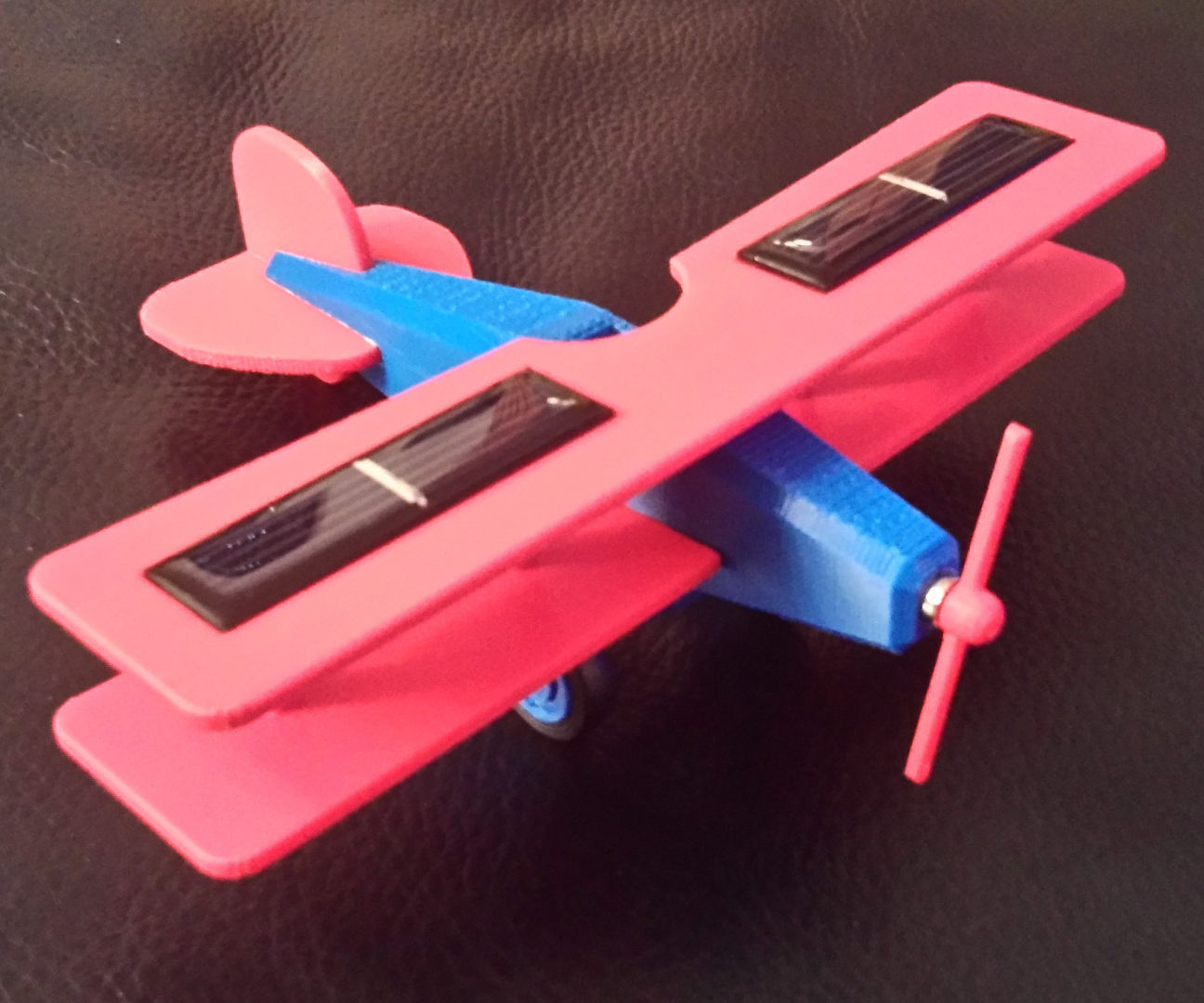 Plane with solar cells and micro motor