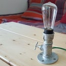 Pipe lamp with dimmer and vintage bulb