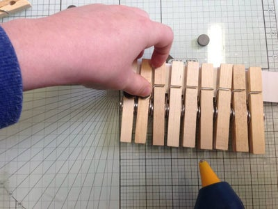 Attach Magnets to Pegs